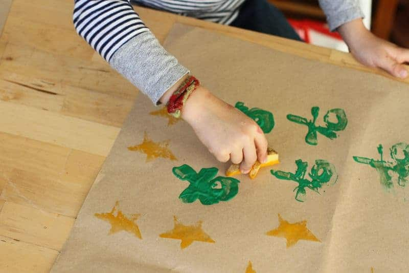 Child decorating wrapping paper