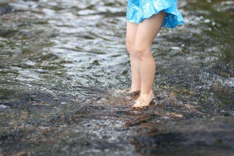 Girl playing in river