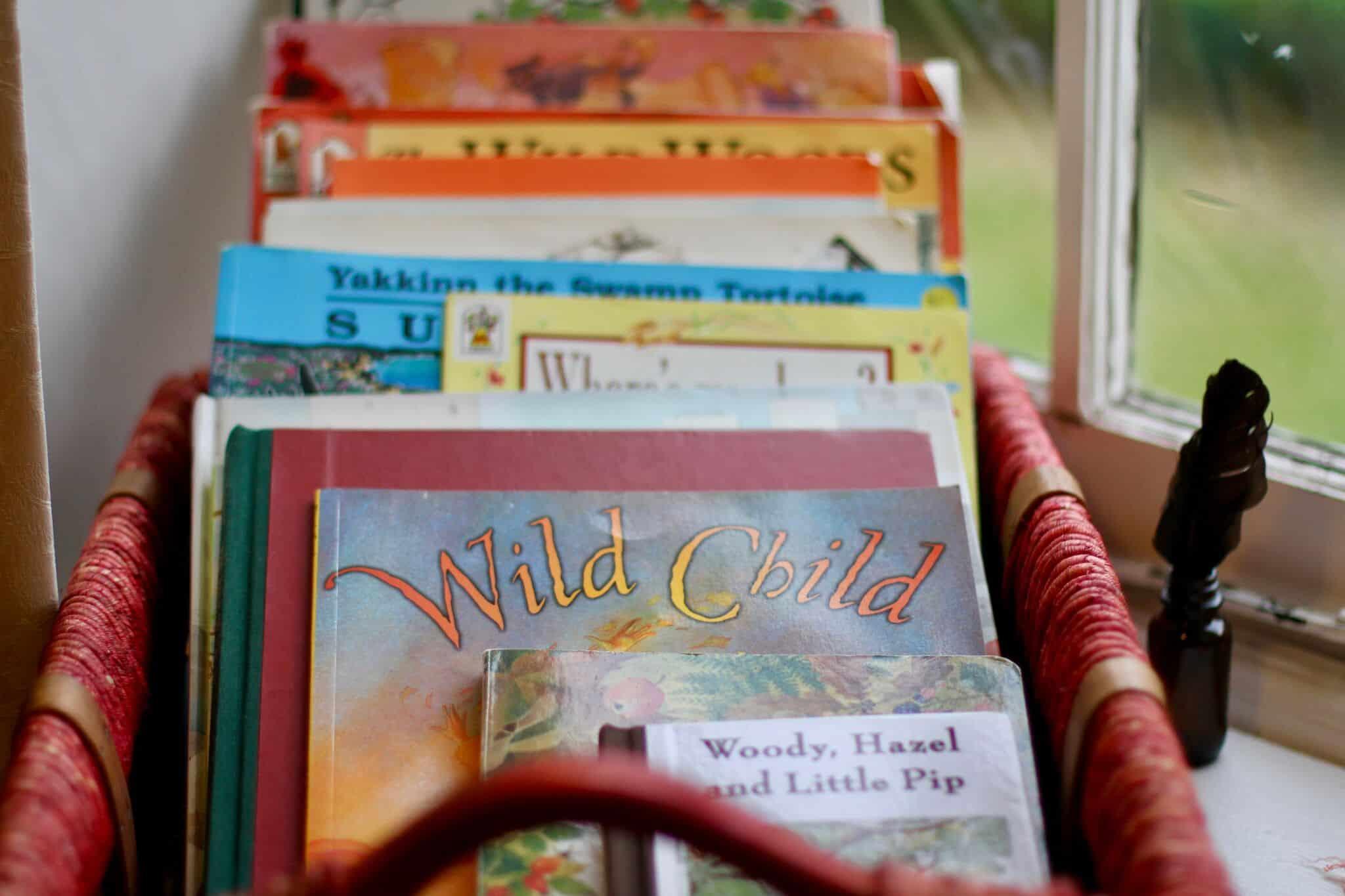 Seasonal children's books in a basket